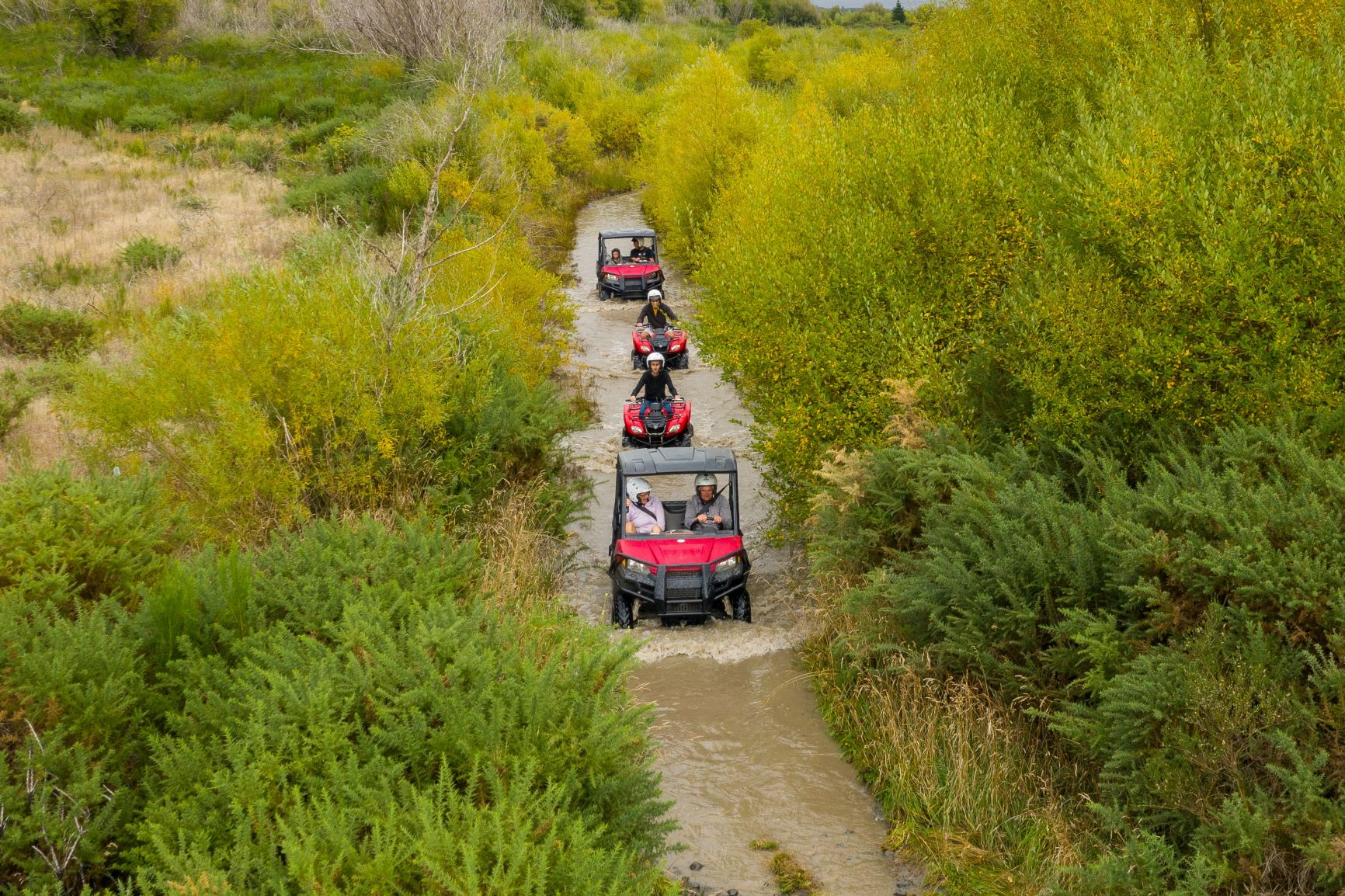 Hanmer Springs Attractions Quad Bikes and Off Road Buggies travelling along a creek