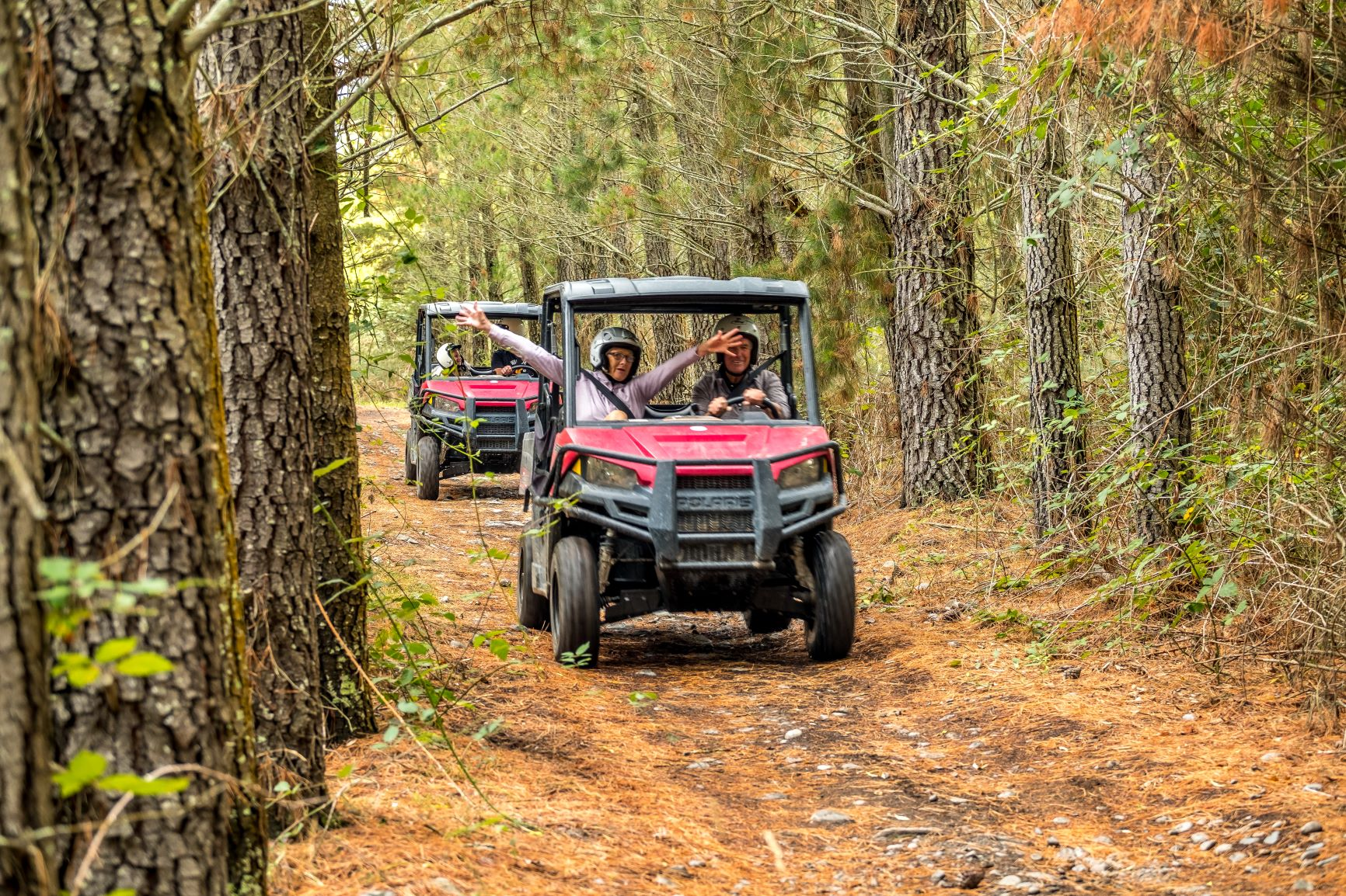Couple on Hanmer Springs Attractions Off Road Buggy through forest