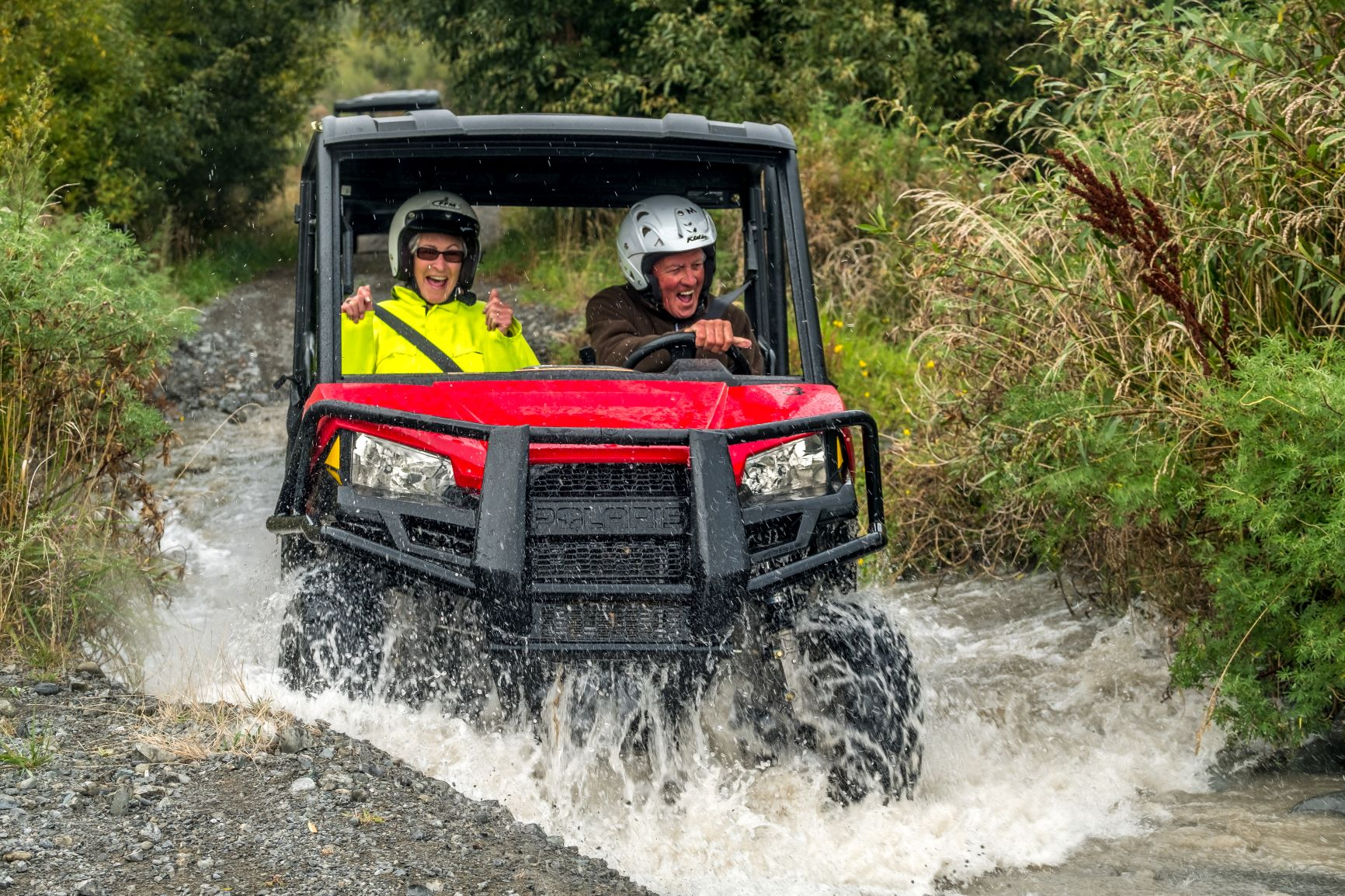 Couple on Hanmer Springs Attractions Off Road Buggy driving through a river